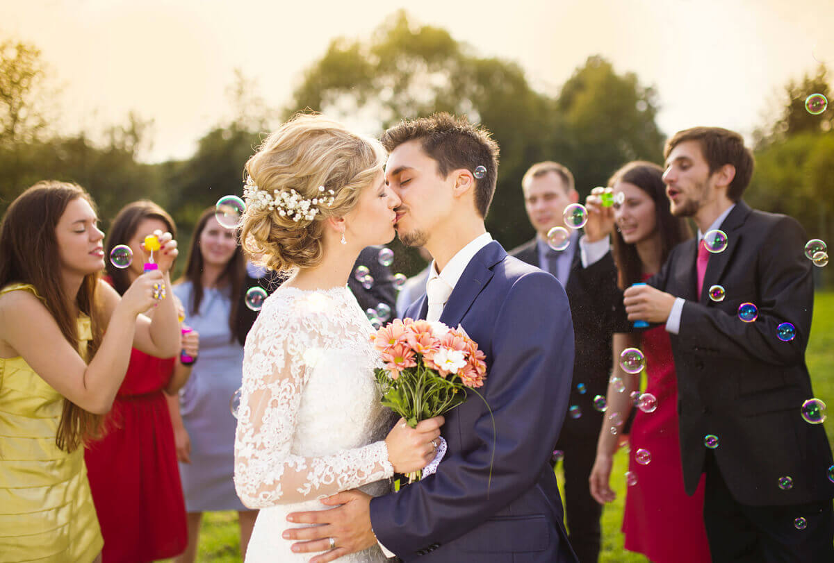 iStock_000049827040_Full.jpg (Newlyweds kissing at wedding reception)